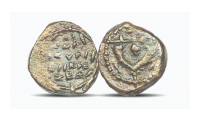 A genuine 2000  year old Jewish bronze coin of the type used by Jesus as an illustration of the way God looks at giving.