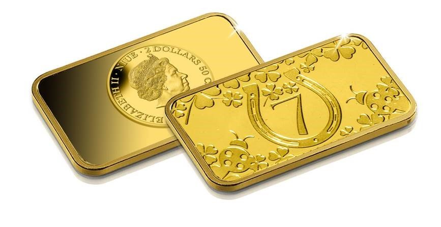 Pure 24 carat gold Lucky Ingot features various lucky symbols such as a four-leaf clover, a horseshoe, a ladybug and lucky number 7.